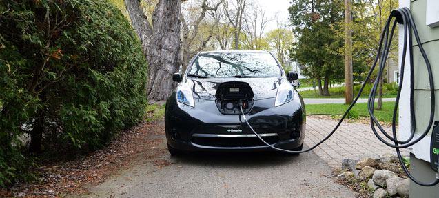 Electric Car Charging At Home In The Driveway